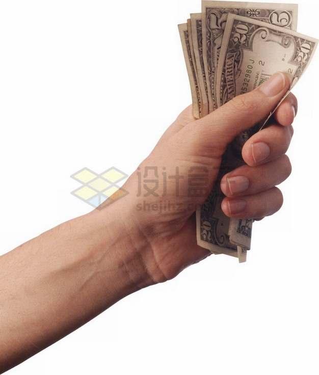 一只手抓着一沓美元钞票png图片素材
