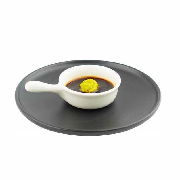 黑色盘子上的一碟芥末酱油调味品873997png图片免抠素材