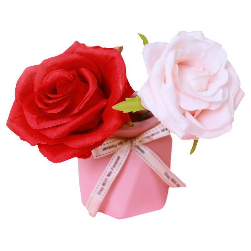 粉色花瓶中的红色和粉红色玫瑰花插花艺术1856856png图片免抠素材 生物自然-第1张