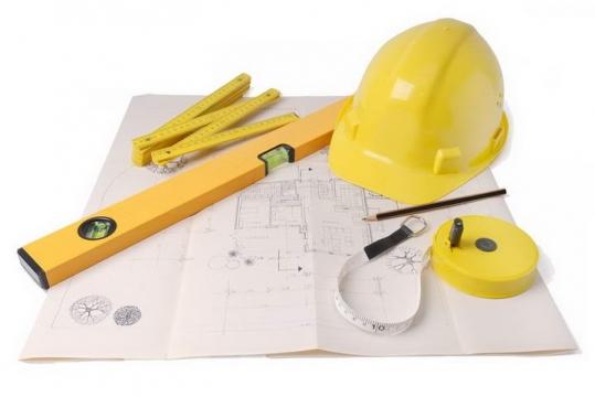 放在建筑图纸上的安全帽水平仪直尺卷尺等建筑行业图片png免抠素材